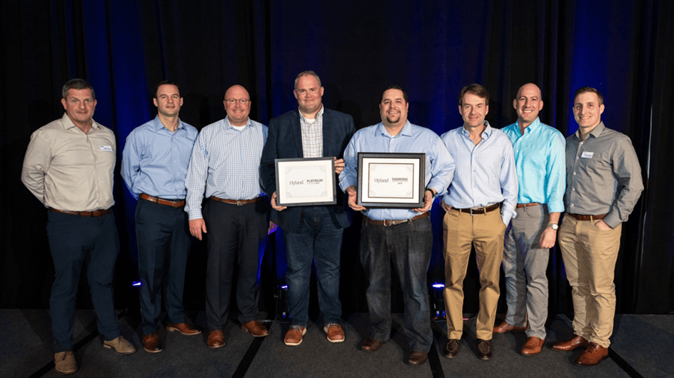Kiriworks team receiving an award from Hyland Software, Platinum and Diamond honors